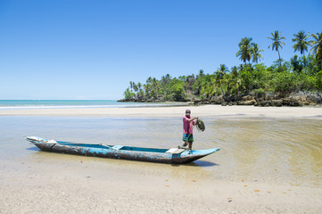Traditional Brazilian dugout fishing boat on the beach in Bahia, Nordeste, Brazil