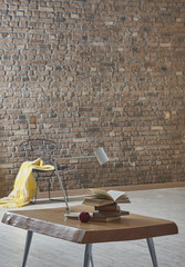 brown brick wall and brown wooden table