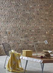 wooden table, brown brick wall and black chair home concept