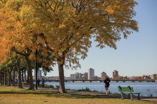 Jogging along the Boston Charles river in autumn, Boston, New England