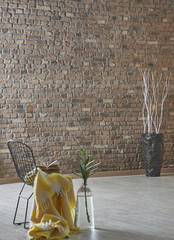 brick wall decoration with black chair