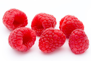 Ripe red raspberries isolated on white background.