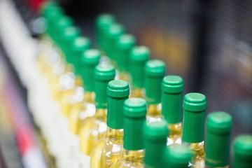 Close up of white wine bottles