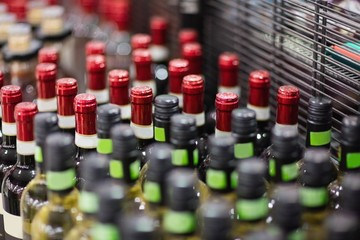 Close up of red and white wine bottles