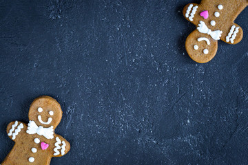 Christmas gingerbread on dark background top view