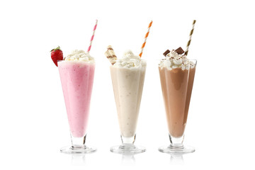Poster Milkshake Delicious milkshakes isolated on white