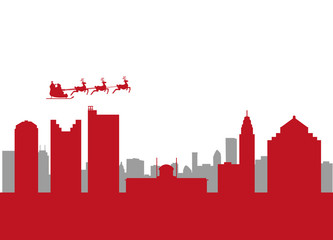 santa flying over the city of columbus