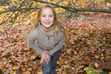 Portrait of pretty young woman outside in the Fall