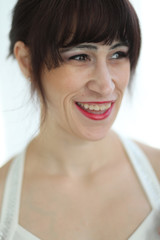 Laughing Woman with Brown Hair and Beautiful Brown Eyes