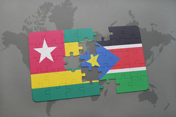 puzzle with the national flag of togo and south sudan on a world map