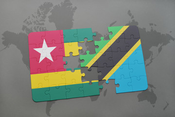 puzzle with the national flag of togo and tanzania on a world map