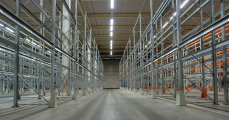 Interior of a warehouse with racks.