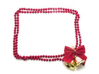 Frame made of pearls with red bow and christmas bells isolated o