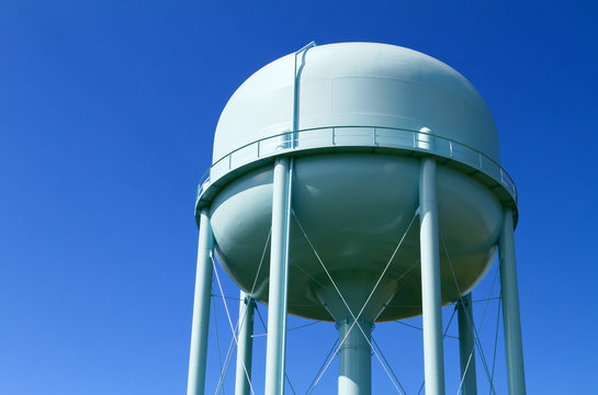 Water tower with blue sky in the background