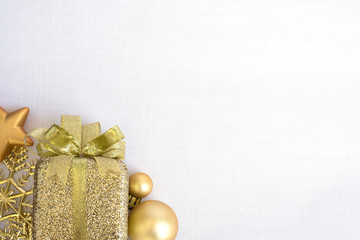 gold gift box with christmas ornaments