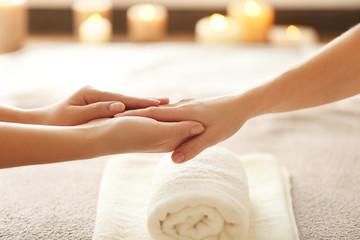 Spa concept. Specialist massaging female hand