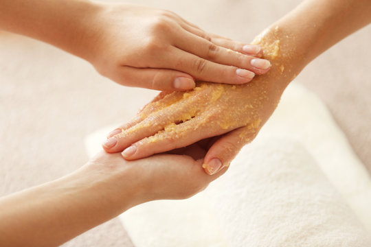 Spa concept. Specialist massaging female hand with scrub