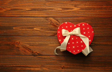 Heart shaped gift box on wooden table
