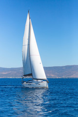 Sailing ship boats with white sails in the Sea. Luxury yachts...