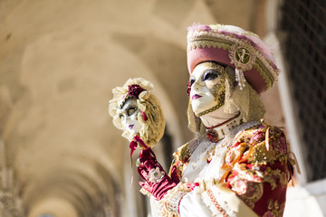 Mask during Venice Carnival in St. Marco Square, Venice, taly