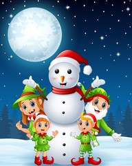 Cartoon christmas elves with snowman in the winter night background