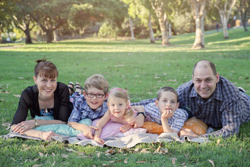 Happy family of five in the park