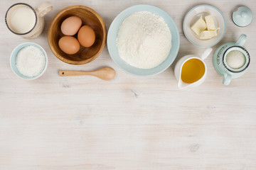 Various bakery ingredients on wood textured table, view from above Wall mural