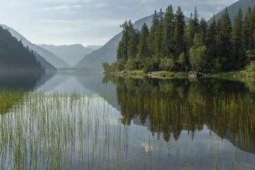 Magic sunrise on a mountain lake. Baikal area