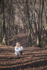 Young woman relaxing outdoor in forest