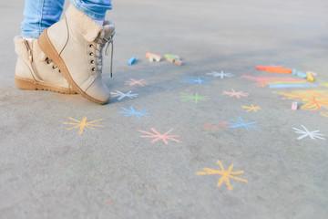 Closeup of child drawn snowlakes on the asphalt