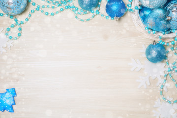 Blue Christmas decorations on wooden background with copy space