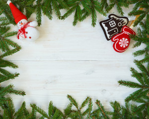 Christmas tree branches christmas decorations on white wooden te