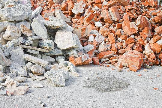 Concrete and brick rubble debris on construction site after a demolition