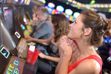brunette girl winning in a casino