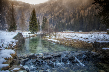 A small mountain river in the Italian Dolomites. Beautiful mount