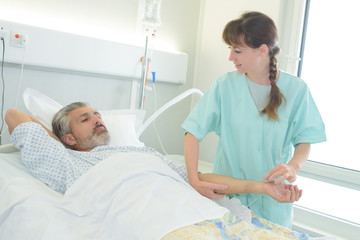 nurse checking on a patients
