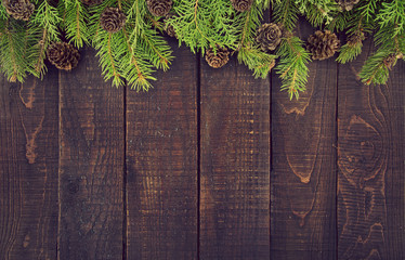 Frame from decorated Christmas tree on rustic wooden background