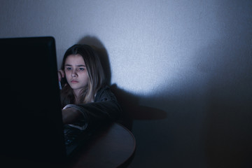 Teen girl excessively sitting at the phone at home. he is a victim of online bullying Stalker social networks
