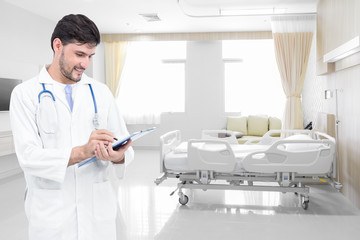 Doctor writing medical records in modern hospital room