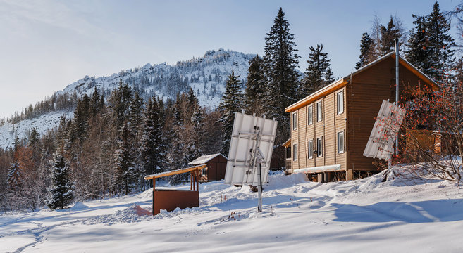 Brown wooden house tourist camp shelter over fantastic winter mountain view