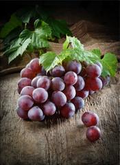 Fototapete - Fresh dark grapes on wood. Autumn fruit. Organic food.