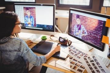 Graphic designer using graphics tablet