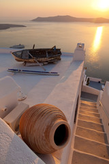 Old boat on the roof of a building in Firostefani, Santorini. Sh
