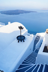 Street view and stairs in Oia, Santorini. The sea and caldera on