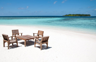 Table and chairs at tropical beach restaurant, Thinadhoo island, Maldives