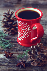 Cup of coffee and  pine cones