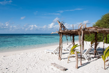 Sunbed at tropical beach, island Thinadhoo, Maldives