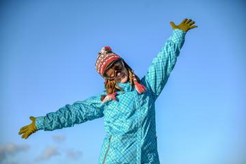 Portrait of a happy girl snowboarding
