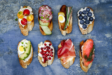 Mini sandwiches food set. Brushetta or authentic traditional spanish tapas for lunch table. Delicious snack, appetizer, antipasti on party or picnic time. Top view.
