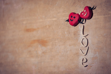 red valentines day hearts on wooden background;